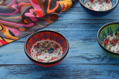 Orient table with spices on blue table Royalty Free Stock Photo