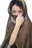 Orient woman. Portrait of a young attractive woman draped in orient style covering her face Royalty Free Stock Photo