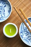 Oriental. Dishes with chopsticks on a bamboo mat royalty free stock photos