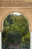 Oriental arch. From palace La Alhambra in Granada, Spain. With view to the garden Royalty Free Stock Images