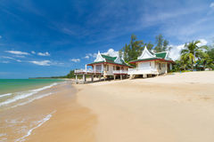 Oriental architecture holiday houses. On the beach of Thailand Royalty Free Stock Photos