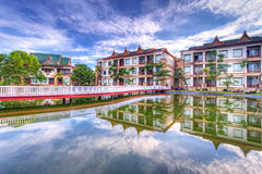 Oriental architecture with reflection. Oriental architecture reflected in the pond at sunrise, Thailand Royalty Free Stock Photo