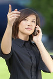 Oriental Asian Chinese Woman On Cell Phone Stock Photography