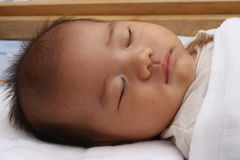 Oriental baby asleep Royalty Free Stock Image