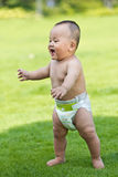 Oriental baby learning to walk Stock Photo