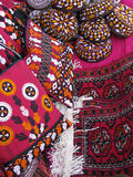 Oriental bazaar objects - bags, rugs and skull-cap. Handmade bags with emboidery, bukhara rugs, skull-caps with embroidery. Traditional handicraft objects at the Stock Photography