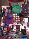 Oriental bazaar objects - doll and embroided bags Stock Photo