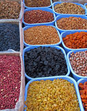 Oriental bazaar objects - dry fruits and nuts. Dry fruits and nuts (apricots, grapes, prunes, walnuts, peanuts, hazelnuts, apricot nuts). Traditional foods at Stock Photography