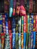 Oriental bazaar objects - silk kerchiefs. Silk kerchiefs.  Traditional oriental objects at the biggest orientall bazaar in turkmenistan tolkuchka close to Royalty Free Stock Images
