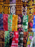 Oriental bazaar objects - silk kerchiefs. Women silk kerchiefs.  Traditional objects at the biggest oriental bazaar in turkmenistan tolkuchka close to ashgabat Stock Photography