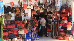 Oriental bazaar in Tunisia. TUNISIA, SOUSSE, JULY 1, 2010: Oriental bazaar in Tunis, Tunisia. Shop with bags in Sousse, Tunisia, July 1, 2010 stock video footage