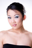 Oriental beauty. Asian face of a oriental beauty with make-up on Stock Image