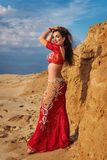 Oriental Beauty belly dancing outdoors stock image