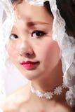 Oriental beauty bride. Oriental beautiful bride's face close-up royalty free stock photo