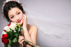 Oriental beauty bride. Isolated on gray background Royalty Free Stock Images