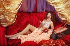 Oriental Beauty holding jewelery Royalty Free Stock Photo