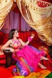 Oriental Beauty holding a tangerine Royalty Free Stock Photos