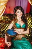 Oriental Beauty plays the tabla Royalty Free Stock Images