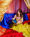 Oriental Beauty plays the tabla Stock Images