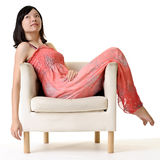 Oriental beauty sit on chair Royalty Free Stock Images