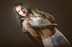 Oriental beauty with tiger Python. Royalty Free Stock Images