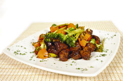 Oriental beef and vegetables. Beef tenderloin oriental or chinese style with brocculi and zucchini and soy sauce stock photo