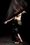 Oriental belly dancer behind black veil Royalty Free Stock Image