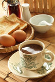 Oriental Breakfast. Traditional oriental breakfast with bread, half-boiled eggs and a cup of coffee Stock Image