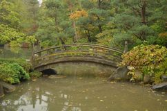 An Oriental Bridge in a Japanese Garden Royalty Free Stock Photography