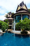 Oriental building near a pool Stock Photos