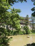 An oriental building and trees and pond stock photo
