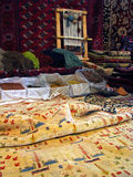 Oriental bukhara rugs - traditional making of. Ingridients for rugs making. natural colorants, handmade bukhara carpets and rugs on foreground and on background Royalty Free Stock Photography