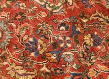 Oriental Carpet. Brightly colored oriental carpet of wool and silk Stock Photo