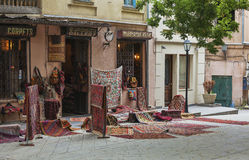 Oriental carpets in the market Stock Photography