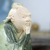 Oriental clay figurine. Clay figurine of an Oriental man stock images