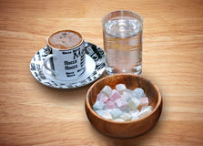 Oriental coffee, a glass of water and oriental delights Royalty Free Stock Photography