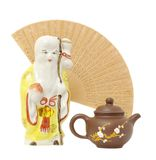 Oriental composition.focus on teapot. Ceramic teapot on fan and shtof back on white Stock Image
