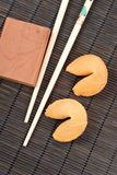Oriental Cuisine Fortune Cookies. On Black Bamboo Royalty Free Stock Photography