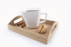 Oriental cup of tea with fortune cookie. Isolated oriental cup of tea with fortune cookie on wooden tray Royalty Free Stock Photos