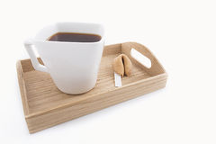 Oriental cup of tea with fortune cookie. Isolated oriental cup of tea with fortune cookie on wooden tray Royalty Free Stock Photography