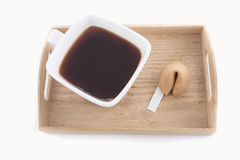 Oriental cup of tea with fortune cookie Stock Photos