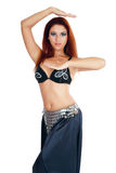 Oriental dancer. Close-medium shot of beautiful belly-dancer in costume and prosessional makeup Stock Photo