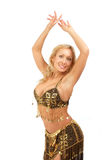 Oriental dancer with hands up. Beautiful blondie in golden-black bellydance costume posing with hands up Royalty Free Stock Photography