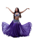 Oriental dancer in purple dress. Isolated on white Stock Images