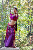 Oriental Dancer. With saber in the park Stock Photos
