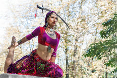 Oriental Dancer. With saber in the park stock photography