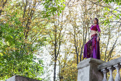 Oriental Dancer. With saber in the park royalty free stock photo