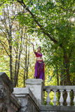 Oriental Dancer. With saber in the park stock images