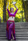 Oriental Dancer. On stairs in the park Royalty Free Stock Photos