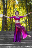 Oriental Dancer. On stairs in the park Stock Photo